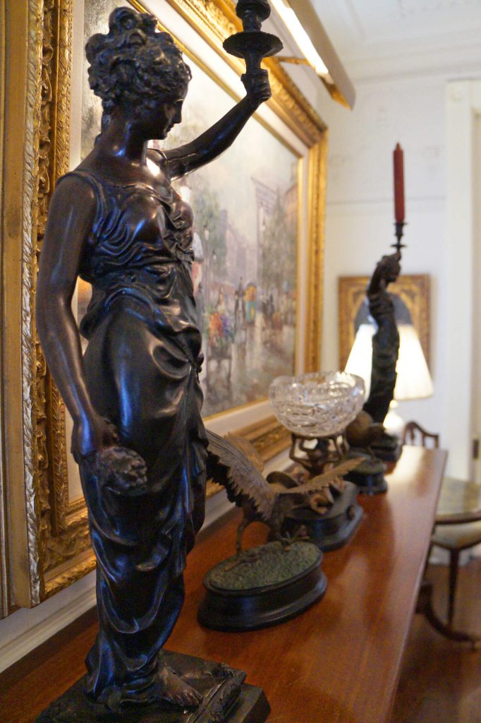 Decorative statues on the parlor mantle